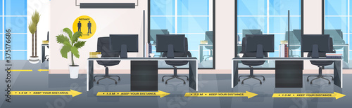 Canvas Print workplace desks with yellow arrows signs for social distancing coronavirus epide