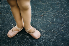 Child's Feet In Ballet Shoes