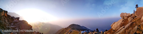 Panoramic shot of mountain landscape on a clear sky background Fototapet