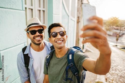 Two happy male tourists taking self portrait Wallpaper Mural