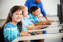 Computer Class: Young Girl Wea...