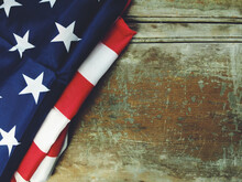The American Flag On A Wooden Background
