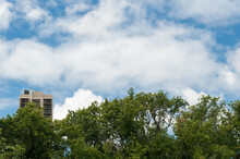 Urban Building Surrounded By Trees And Sky