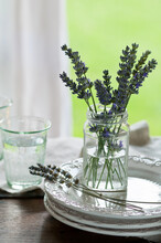 A Glasses Jar With Some Lavender Sprigs