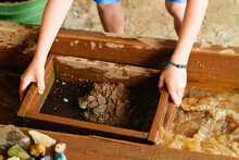 Child Mining For Gemstones Using Sifting Basket