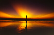 Dramatic Beach Sunset And Woman In Silhouette