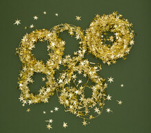 Rings Of Gold Star Tinsel On Green