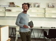 Smiling African Businessman Ho...