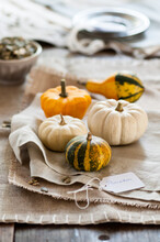 Some Small Pumpkins Placed On Napkins