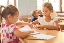 Two Cute Little Girls In A Classroom