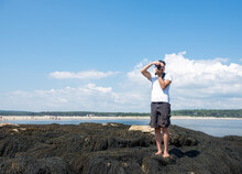 Man Stands On Seaweed At A Bea...
