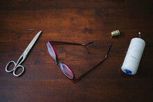Old Scissors, Glasses And Sewing Thread