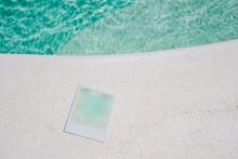 Blue Polaroid Against Water