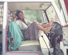 Woman In Drivers Seat Of Van W...