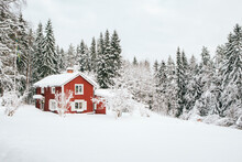 Red Cottage In Snowy Swedish Landscape