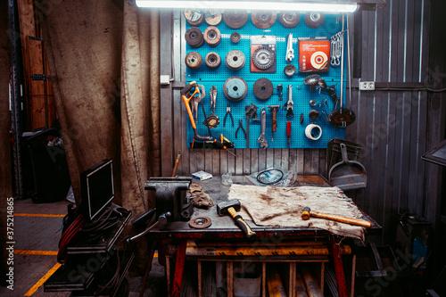 locksmith's workplace  Angular grinding machine Fototapet