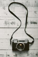 Overhead View Of Analog Camera On The Wooden Background