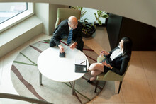 Elevated Vantage Point Of Two Executives In An Animated Discussi