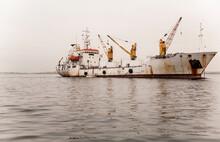 Cargo Ship At Anchor