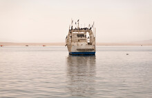 Fishing Trawler At Anchor In A Calm Harbour