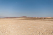 Desert Location With Barren Hills In The Distance