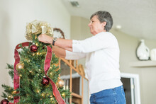 Woman Decorates Her Christmas ...
