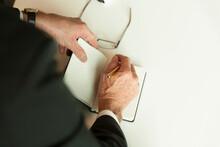Detail Of Senior Executive Writing Notes