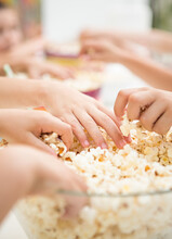 Hands Taking Popcorn