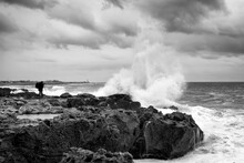 Photographer And Stormy Seas