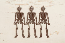 Plastic Skeletons On Old Painted Wood Background