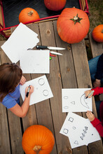 Pumpkins: Kids Work On Making Spooky Faces For Pumpkins