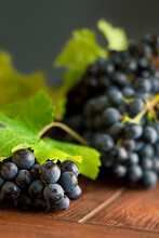 Black Grapes On A Wood Table