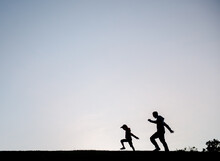 Silhouette Of A Father And Son...