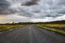 Storm Clouds Over Empty Country Road