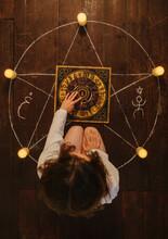 Woman Sitting Inside A Pentagr...