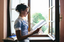 Girl Studying At The Window.