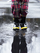 Child Wearing Rubber Boots Spl...