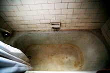 Dirty And Abandoned Empty Bathtub