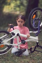 Girl Fixing Her Bike
