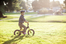 Asian Kid Riding A Bicycle Outdoor