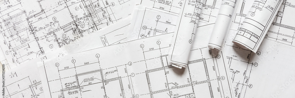 Fototapeta architect design working drawing sketch plans blueprints and making architectural construction model in architect studio,flat lay.