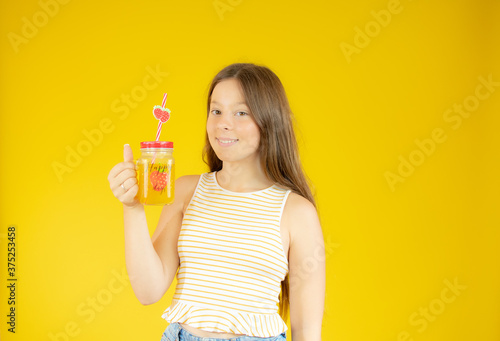 Smiling beautiful girl with long hair with a juice Canvas Print