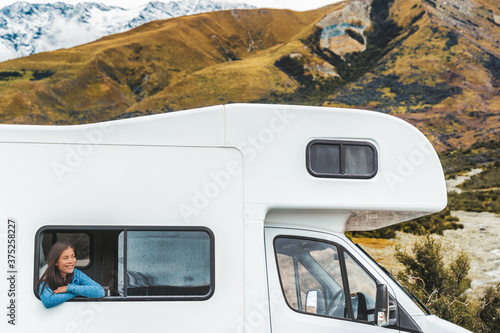 Leinwand Poster RV road trip tourist woman looking out the window of her motorhome on New Zealand travel