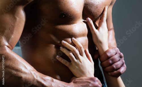 Obraz na plátně Womans hand touch naked mans bare torso