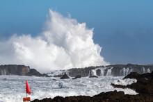 Big Waves Crashing On A Rocky Shore