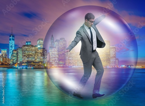 Fotomural The businessman flying inside the bubble