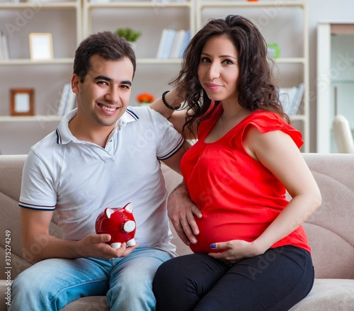 The young couple family expecting a baby Wallpaper Mural