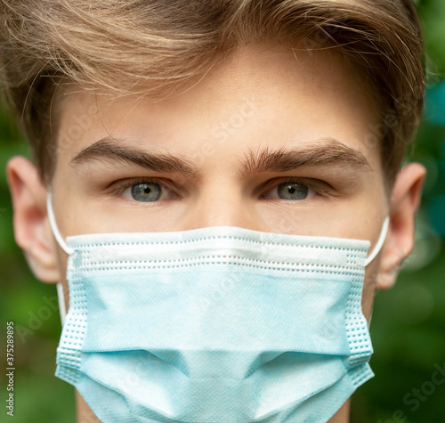 teenager in the mask in a pandemic coronavirus Wallpaper Mural
