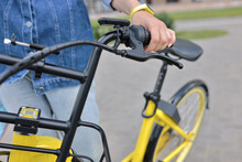Bicyclist Holds Yellow Bicycle...