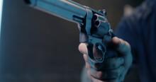 Unrecognizable Man Reloading Revolver In Shooting Range